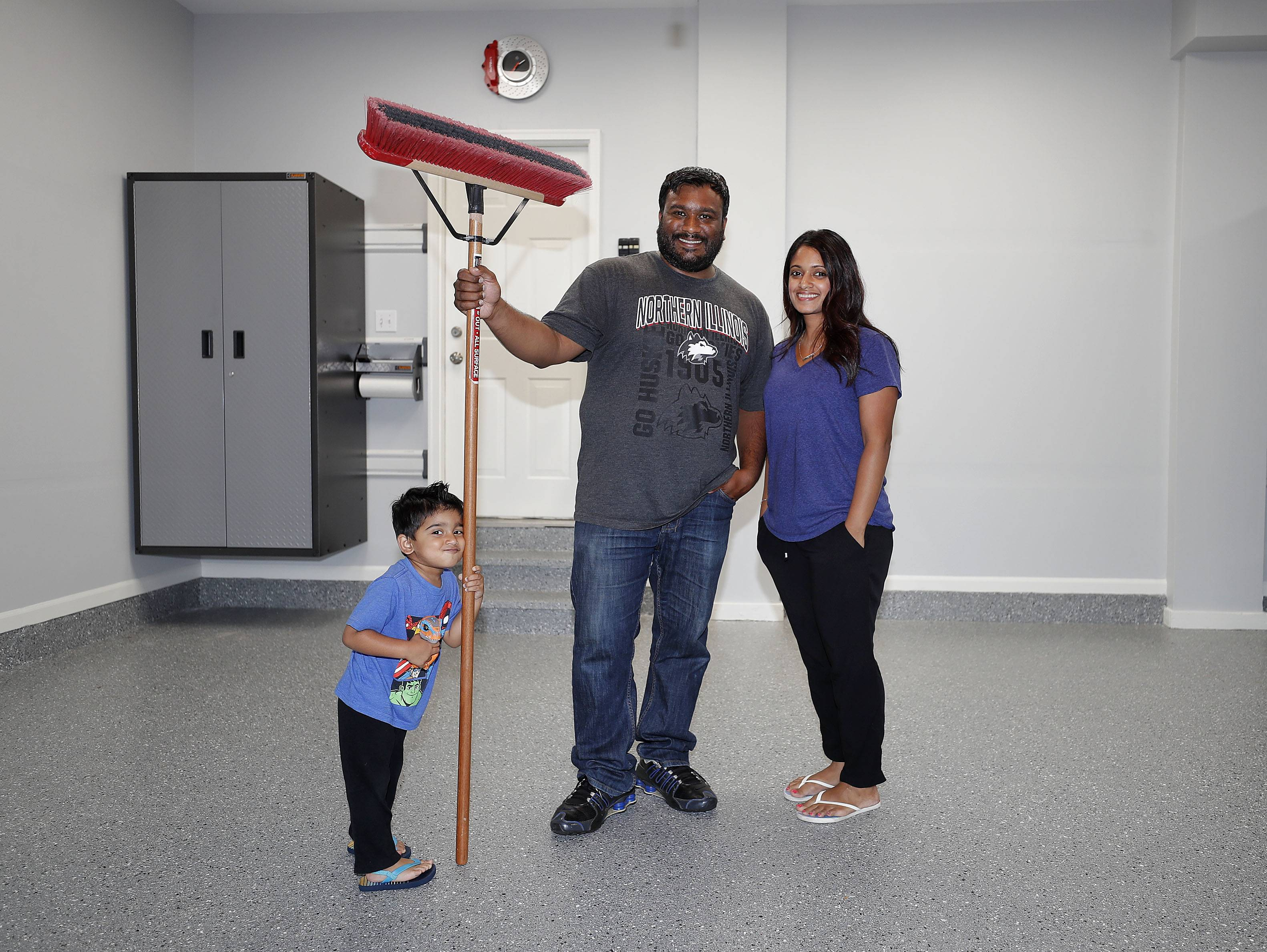 Matt Joseph of Vernon Hills poses with his wife Elena, right, and 3-year-old son Isaac in their newly renovated garage. Joseph won a garage makeover sponsored by the Garage Store and Daily Herald.