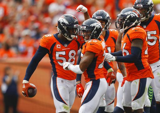 4e095517db8 Denver Broncos linebacker Von Miller (58) reacts with teammates after  grabbing a turnover during