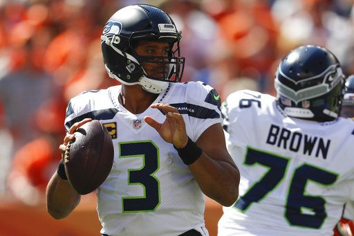 Miller leads Broncos past Seahawks 27-24