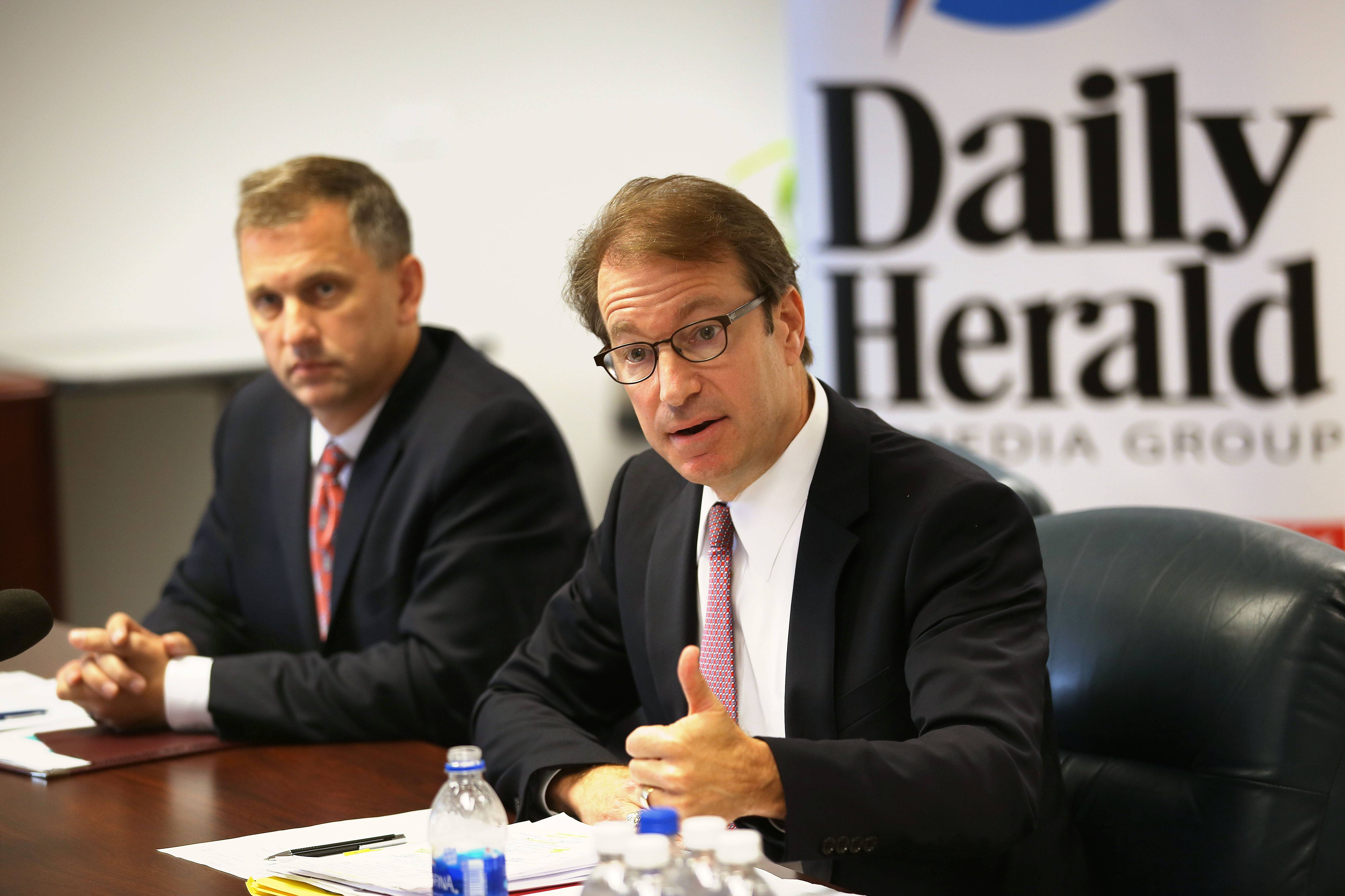 Incumbent Republican Peter Roskam of Wheaton, right, and Democratic challenger Sean Casten of Downers Grove say taxes are the biggest issue dividing them in the race to represent the 6th U.S. Congressional District. The two met with the Daily Herald editorial board Monday.