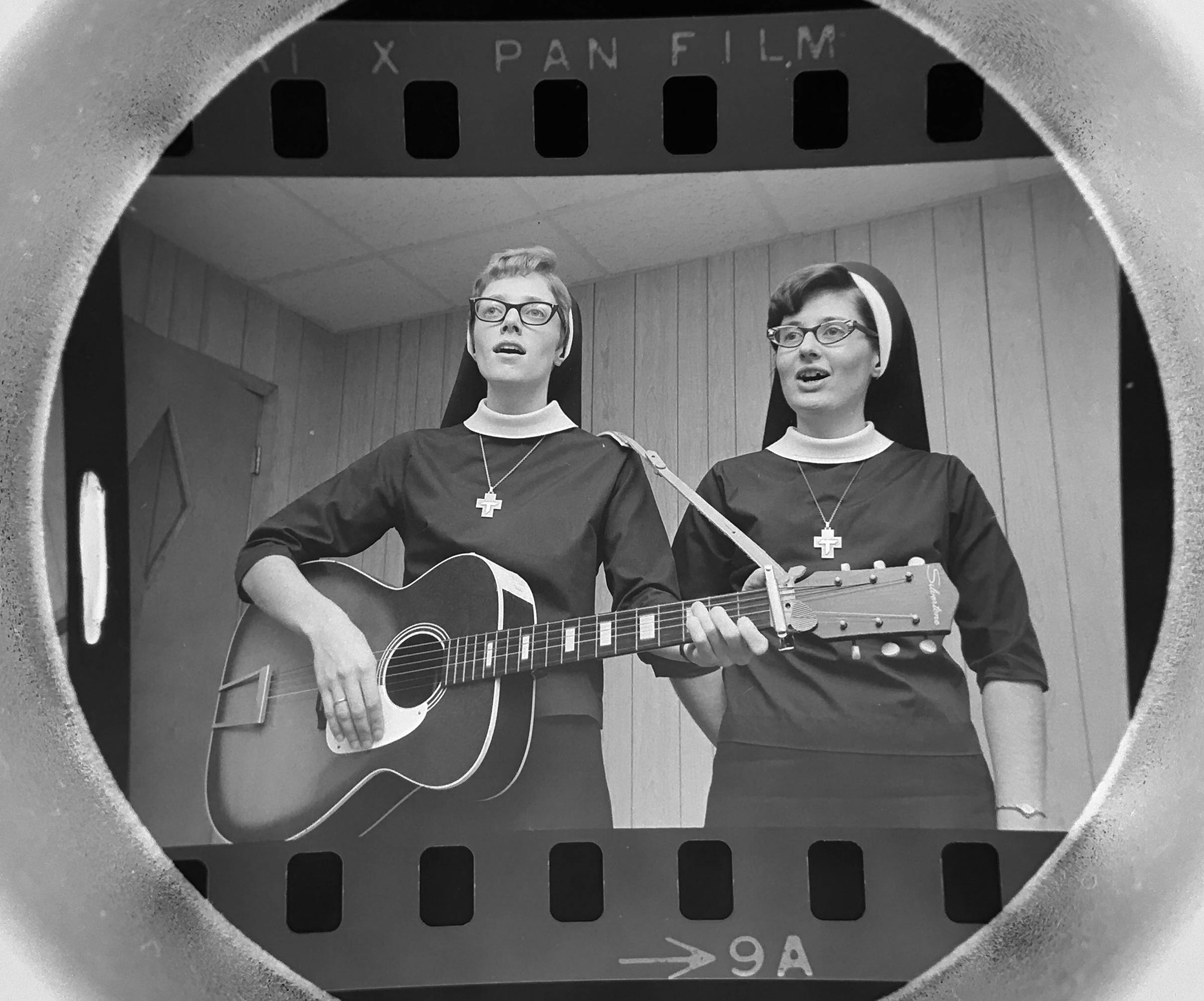 The Daily Herald Archive, Assignment # 8,544, Tom Grieger photo: Sister Mary Anne, left, and Sister Diane, both teachers at St. Walter School in Roselle, formed a folk band and were practicing their singing in November of 1967.