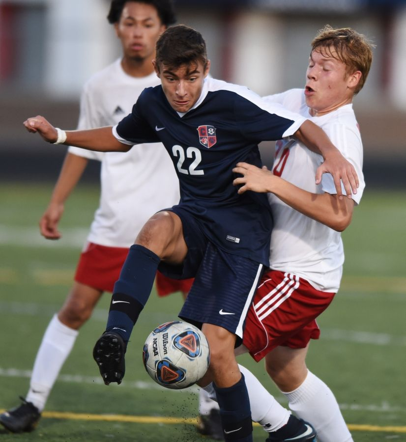 Conant's Connor Conte and Palatine's James Hawran make contact while pursuing the ball during Tuesday's soccer match in Hoffman Estates.