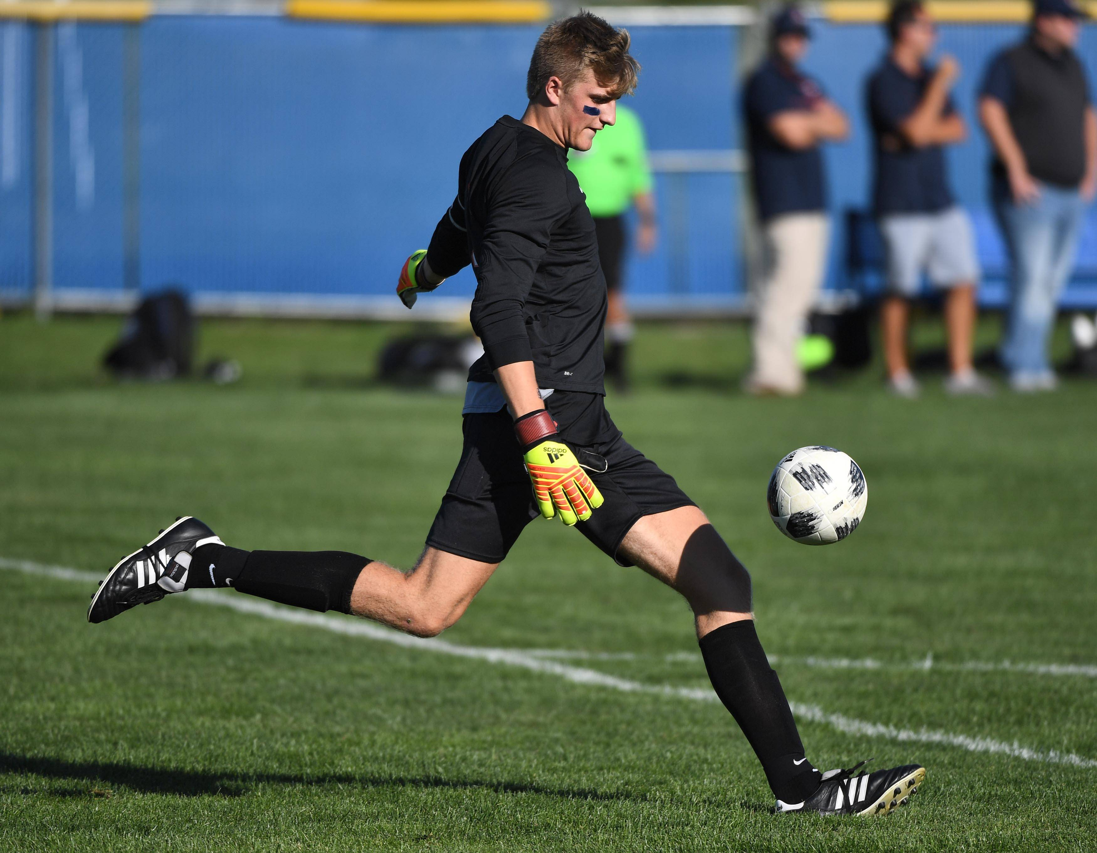 Naperville North goalkeeper Tommy Welch puts the ball in play against Neuqua Valley in a boys soccer game Tuesday in Naperville.