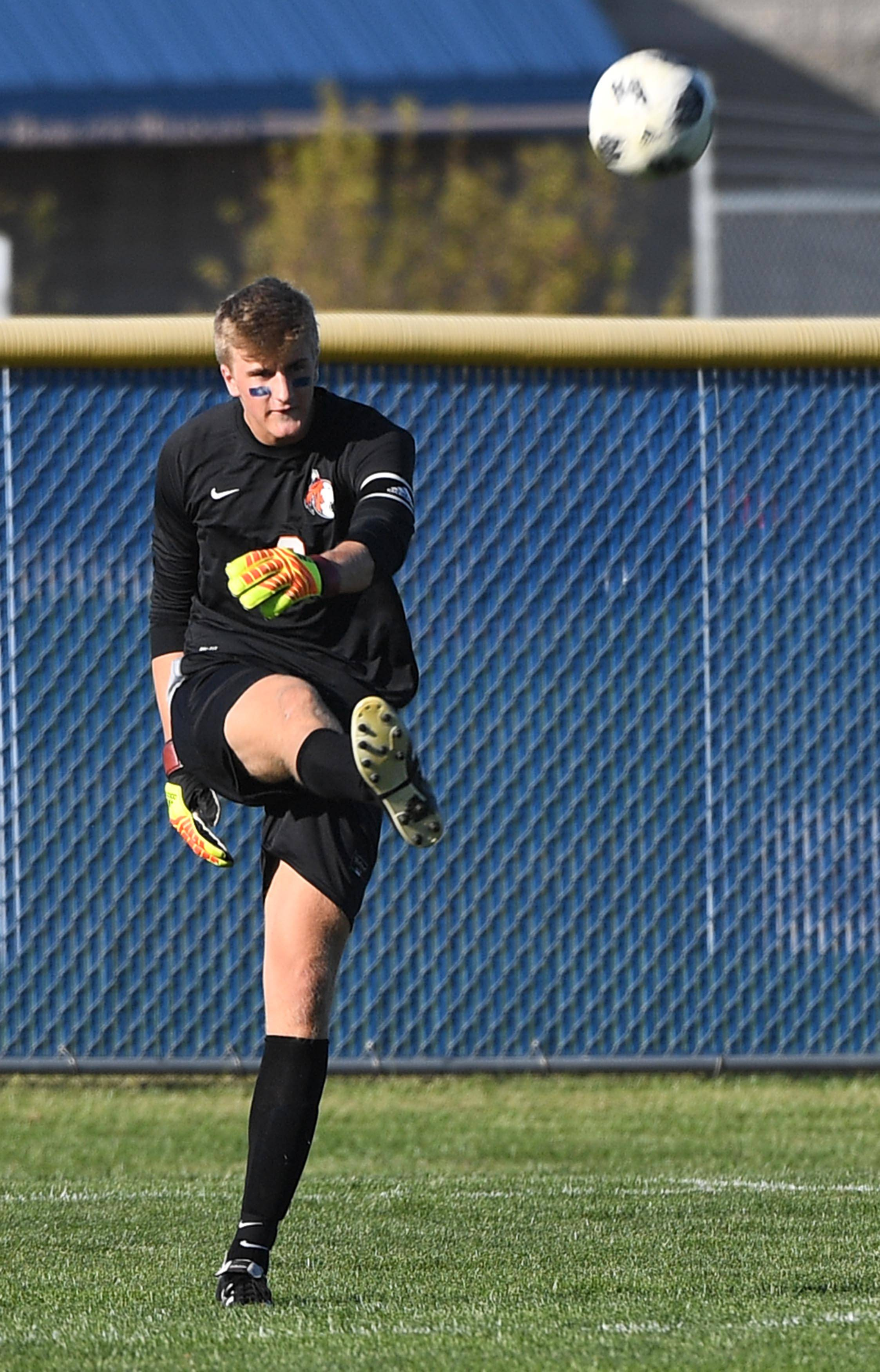 Naperville North goalkeeper Tommy Welch sends the ball upfield against Neuqua Valley in a boys soccer game Tuesday in Naperville.
