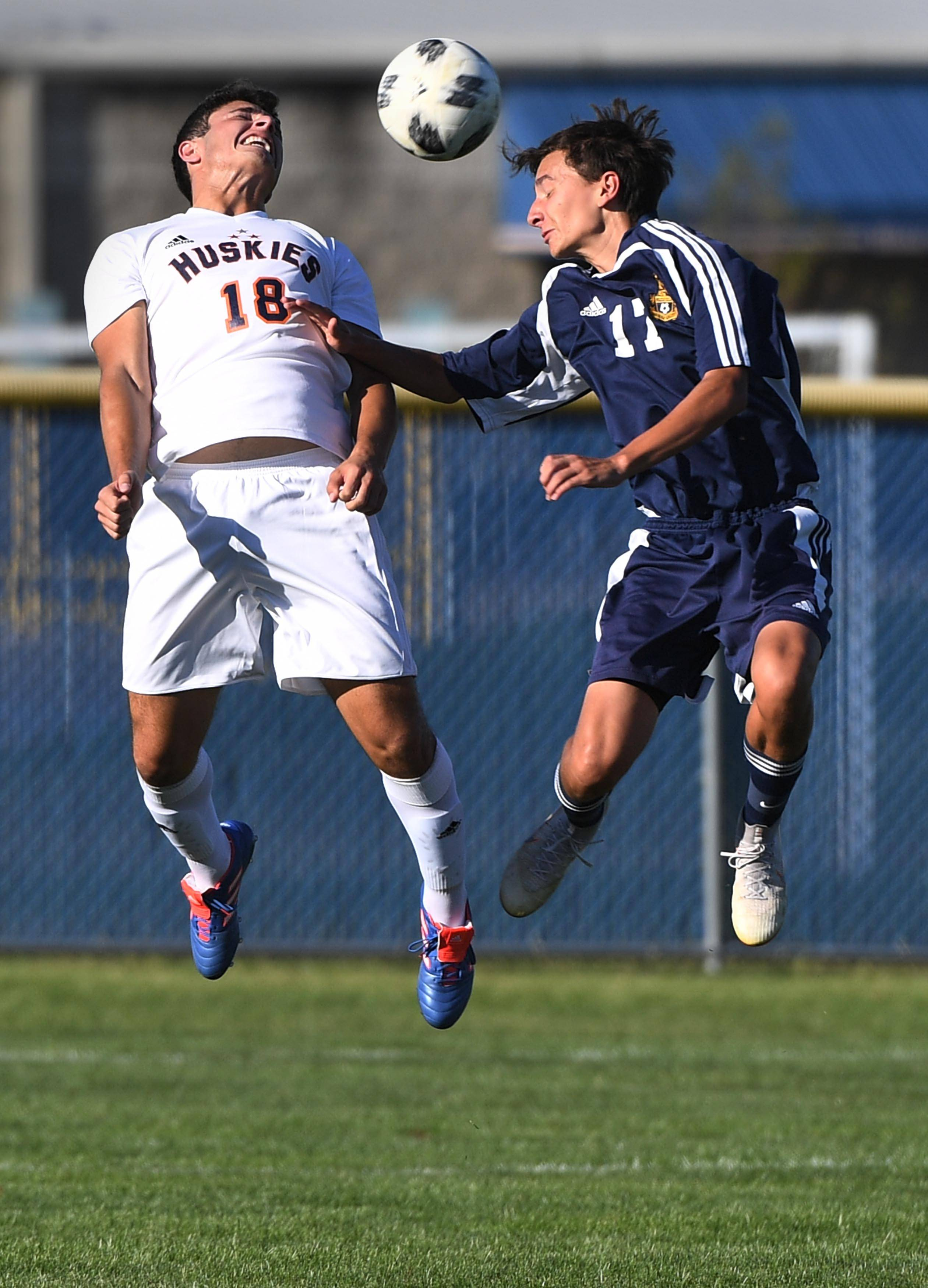 Naperville North's Christian Romano and Neuqua Valley's Jaison Chisnell compete for  a header in a boys soccer game Tuesday in Naperville.
