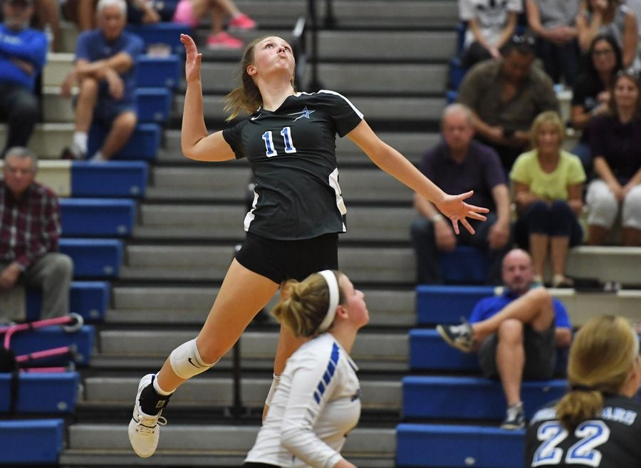 St. Charles North's Katie Lanz skies for one of her 7 kills against Geneva Tuesday in Geneva.