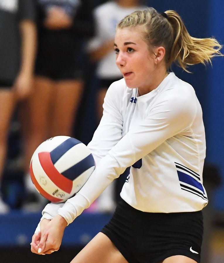 Geneva's Elizabeth Ford hits from the back row against St. Charles North Tuesday in a girls volleyball game in Geneva.