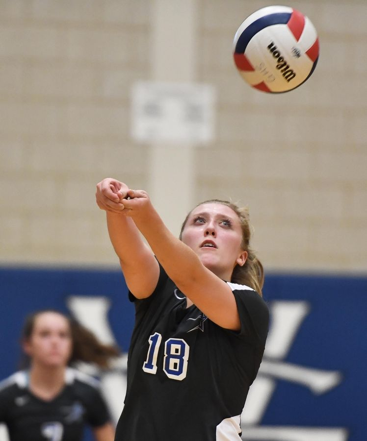 St. Charles North's Lauren Ringness passes the ball.
