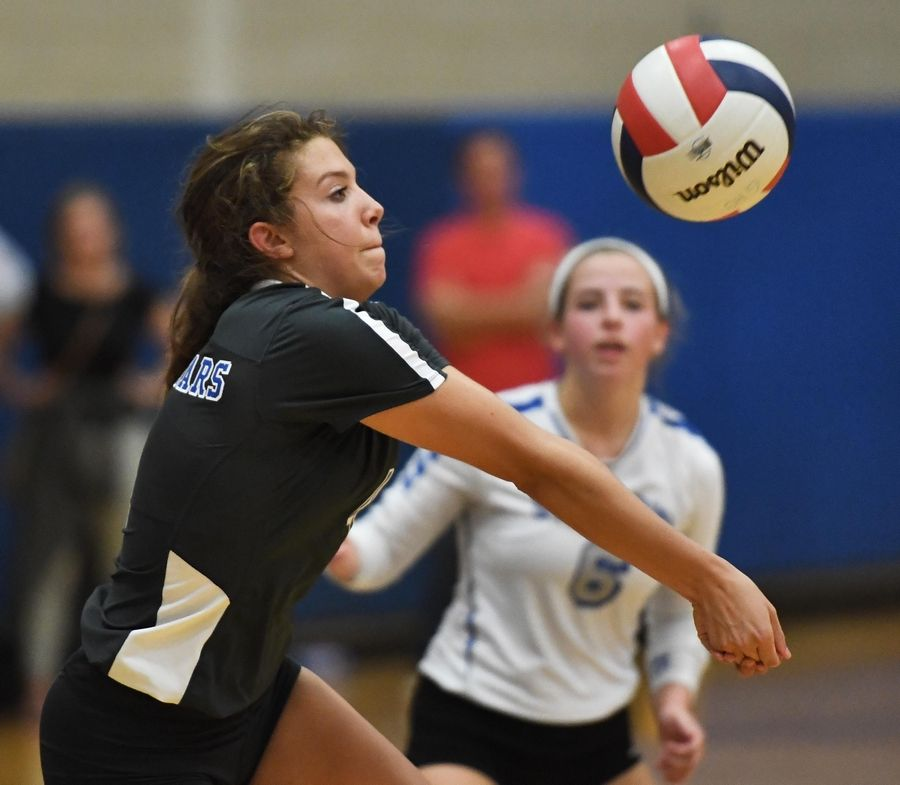 St. Charles North's Olivia Oborne bumps the ball against Geneva Tuesday in a girls volleyball game in Geneva.