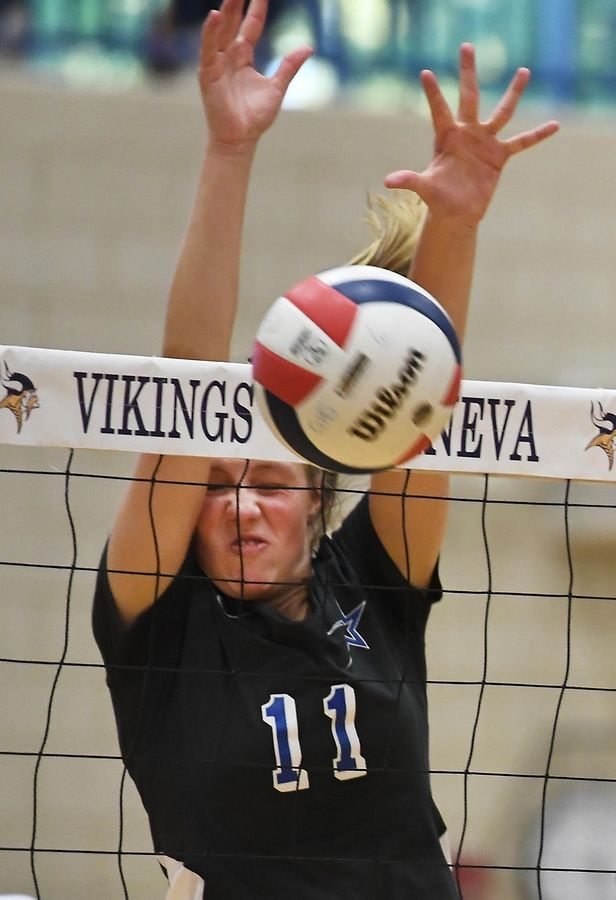 St. Charles North's Katherine Lanz blocks a shot by Geneva's Elizabeth Ford Tuesday in a girls volleyball game in Geneva.