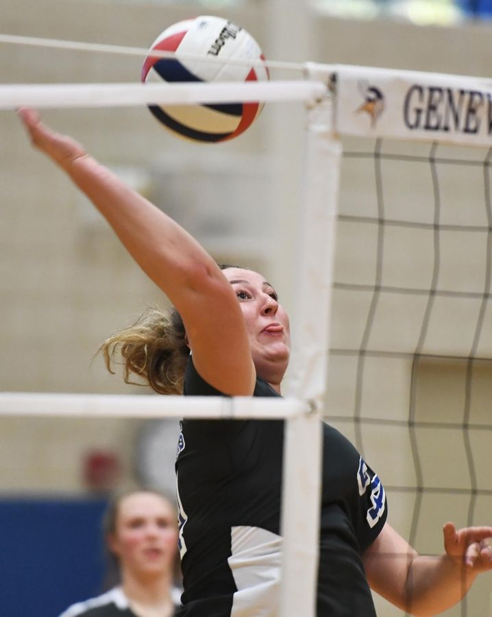 St. Charles North's Brigid McCarthy hits against Geneva Tuesday in a girls volleyball game in Geneva.