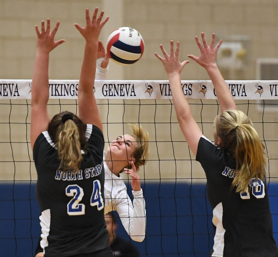 Above: St. Charles North's Brigid McCarthy, left, and Shaine Thomas try to block Geneva's Eli Ford Tuesday in Geneva.Right: St. Charles North's Lauren Ringness passes the ball.