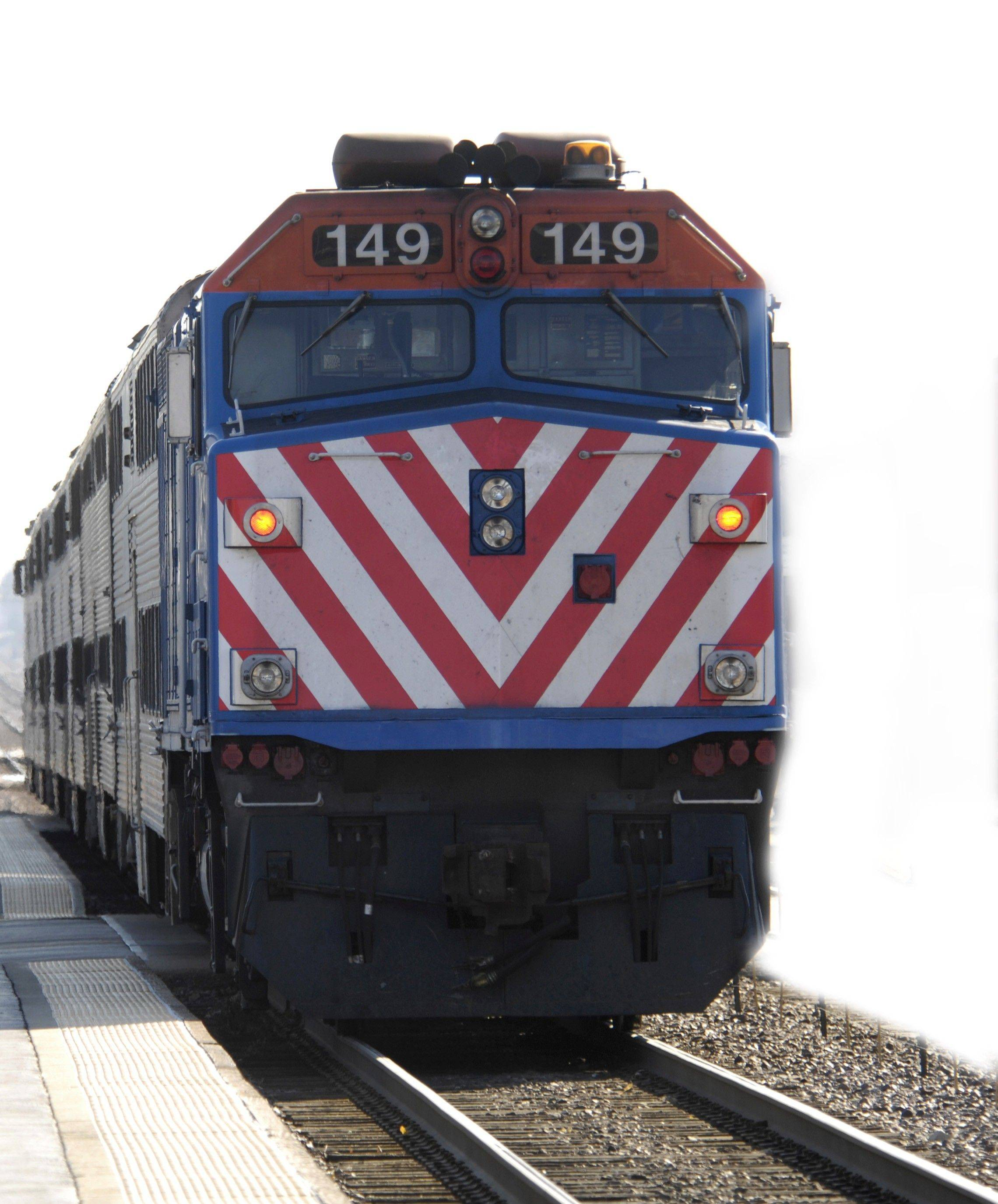 Metra riders get a break from fare hikes next year, but the rail agency threatens big service cuts unless the state increases funding.