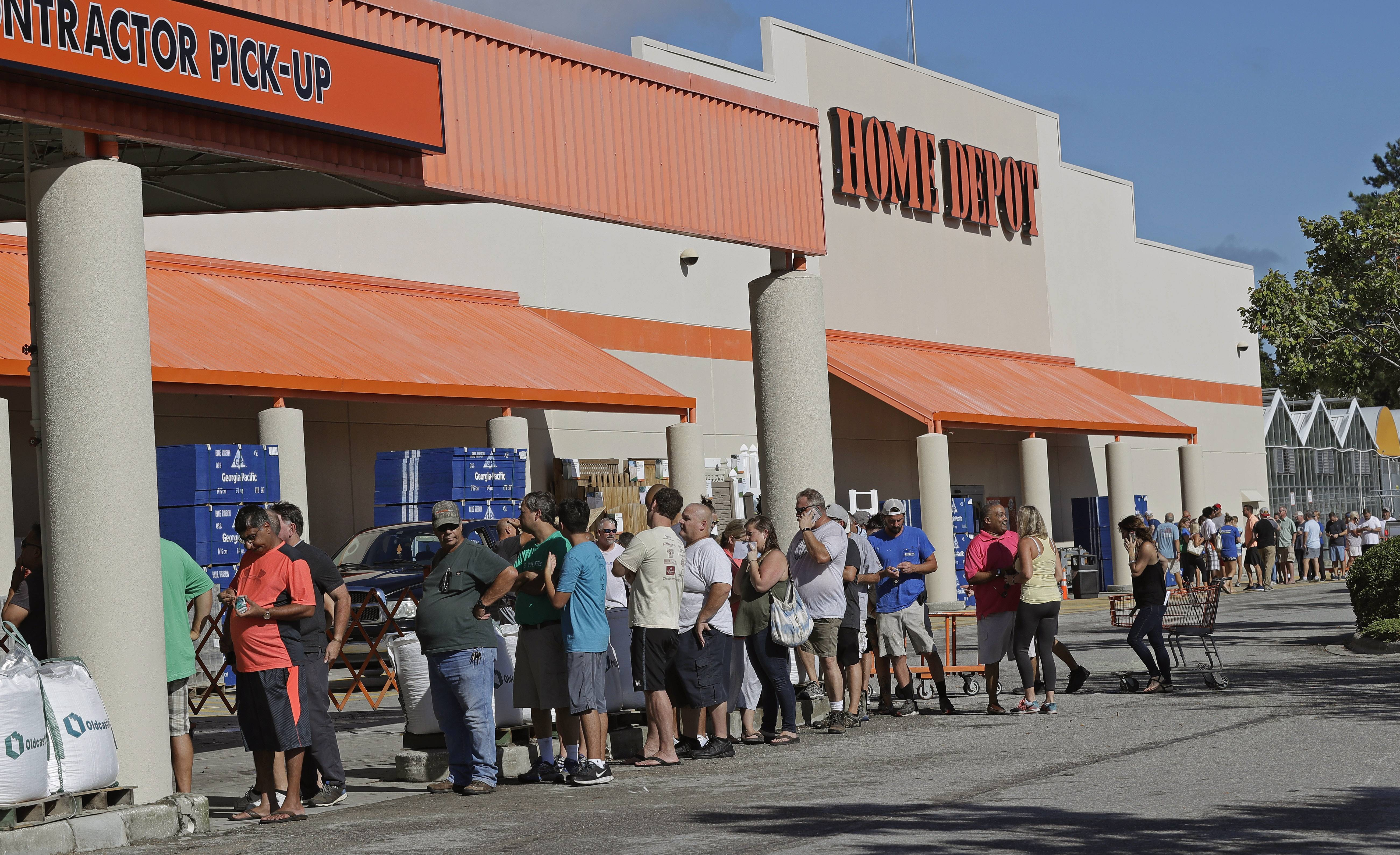 People line up outside a Home Depot for a new supply of generators and plywood in advance of Hurricane Florence in Wilmington, North Carolina, Wednesday. Florence exploded into a potentially catastrophic hurricane Monday as it closed in on North and South Carolina, carrying winds up to 140 mph and water that could wreak havoc over a wide stretch of the eastern United States later this week.