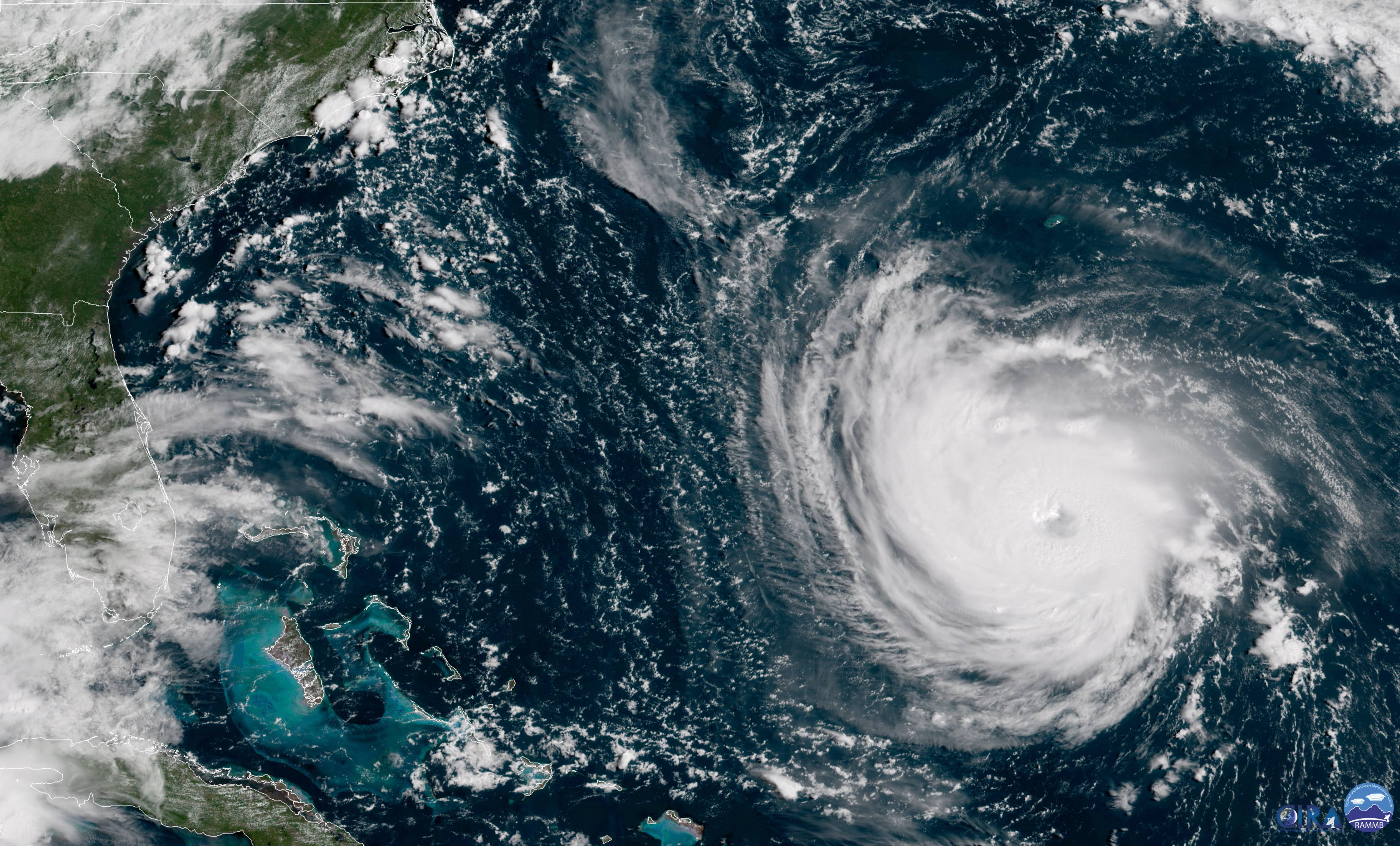 This GOES East satellite image taken Tuesday at 10:30 a.m. EDT, and provided by NOAA shows Hurricane Florence in the Atlantic Ocean as it threatens the U.S. East Coast, including Florida, Georgia, South and North Carolina. Millions of Americans are preparing for what could be one of the most catastrophic hurricanes to hit the Eastern Seaboard in decades. Mandatory evacuations begin at noon Tuesday, for parts of the Carolinas and Virginia.