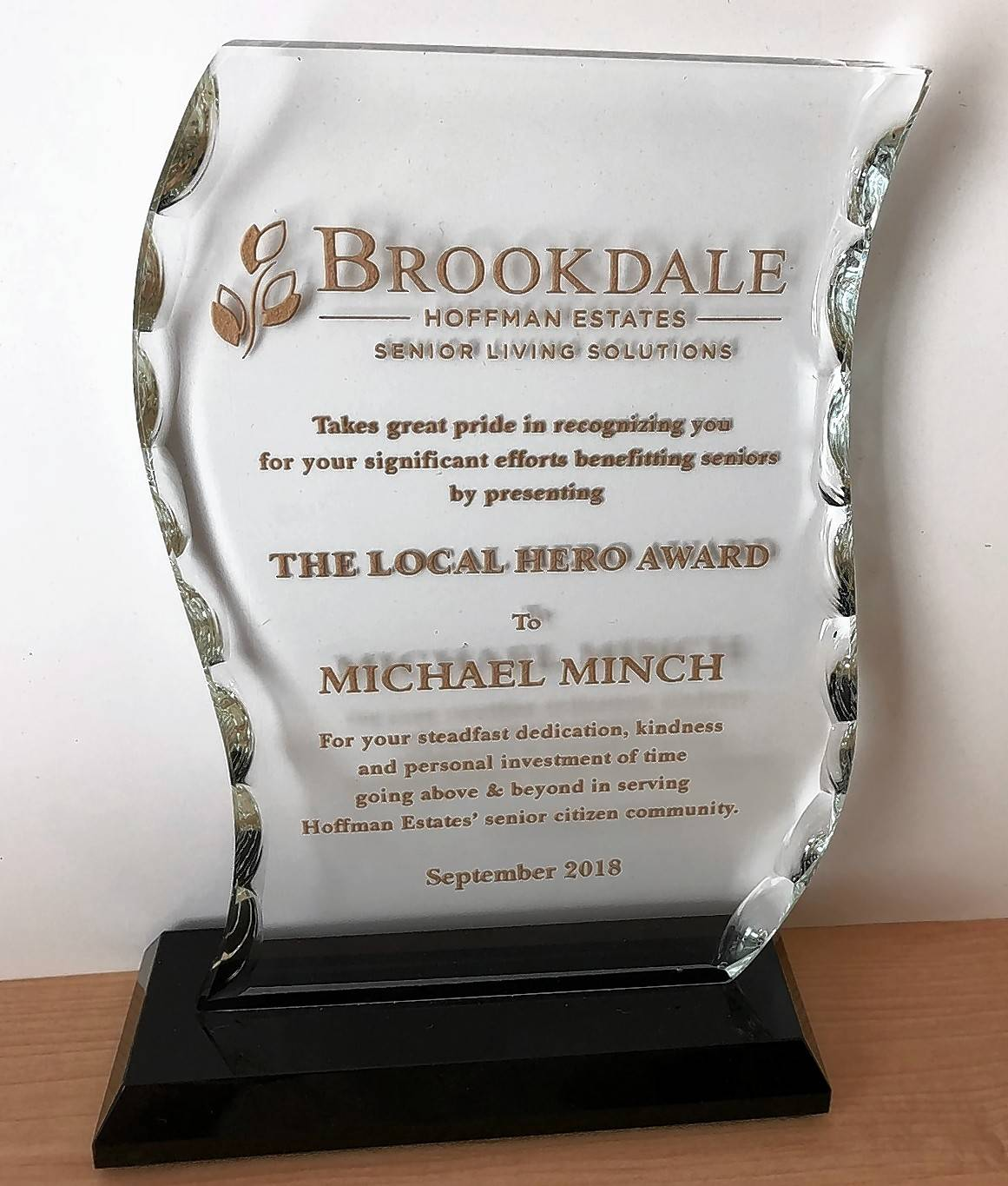 Schaumburg resident Michael Minch's Local Hero Award that he received from Brookdale Hoffman Estates Senior Living Solutions Tuesday afternoon at a ceremony intended to honor the spirit of the heroes who helped others on Sept. 11, 2001.