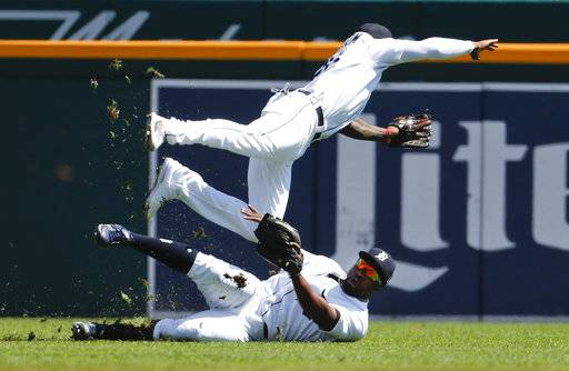 Detroit Tigers left fielder Christin Stewart, bottom, makes the catch on a Houston Astros' Evan Gattis fly ball as shortstop Niko Goodrum (28) collides with him in the second inning of a baseball game in Detroit, Wednesday, Sept. 12, 2018.