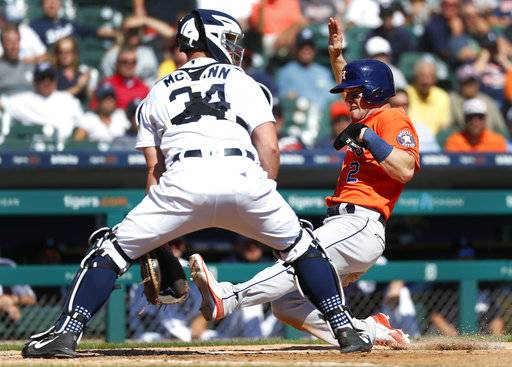 Houston Astros' Alex Bregman (2) scores at home plate as Detroit Tigers catcher James McCann (34) waits for the throw in the fifth inning of a baseball game in Detroit, Wednesday, Sept. 12, 2018.