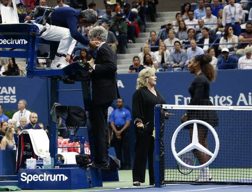 Chair umpire Carlos Ramos, left, talks with referee Brian Earley as Serena Williams talks with Donna Kelso during the women's final of the U.S. Open tennis tournament against Naomi Osaka, of Japan, Saturday, Sept. 8, 2018, in New York.