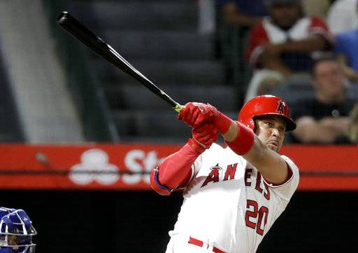 Los Angeles Angels' Jose Fernandez watches his home run against the Texas Rangers during the second inning of a baseball game in Anaheim, Calif., Tuesday, Sept. 11, 2018.