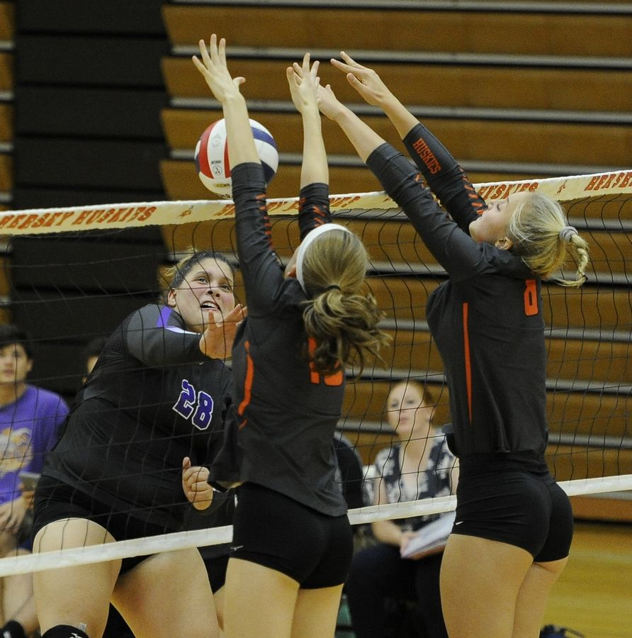 Rolling Meadows' Leticia Avellaneda slams one against Hersey's dynamic duo of Nora Zielke and Juliette van den Herik but fails to score the point because of the block at Hersey on Thursday.