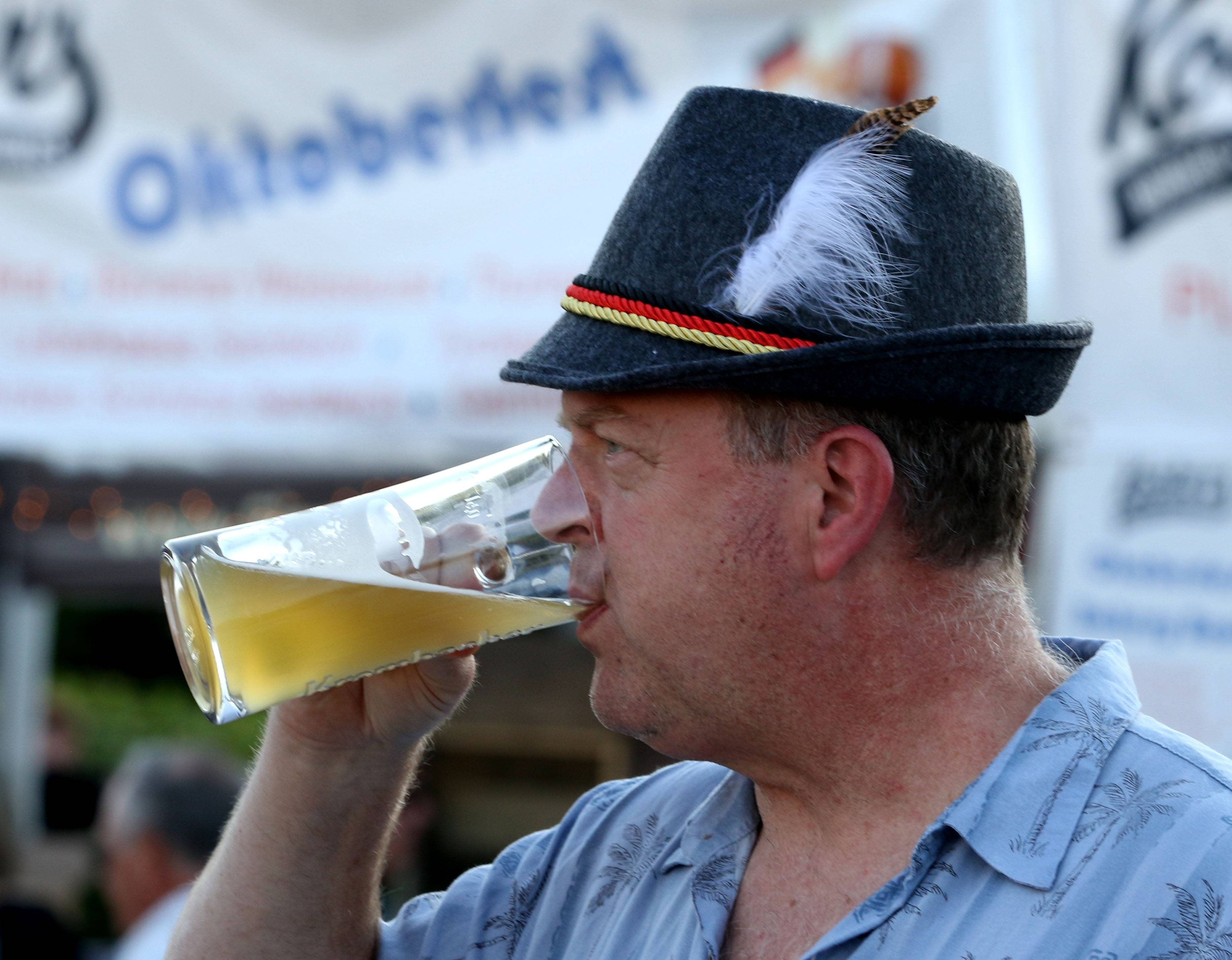 Greg Ivaska of Mount Prospect takes a swig of his beer Friday night during the Rotary Club of Palatine's Oktoberfest.