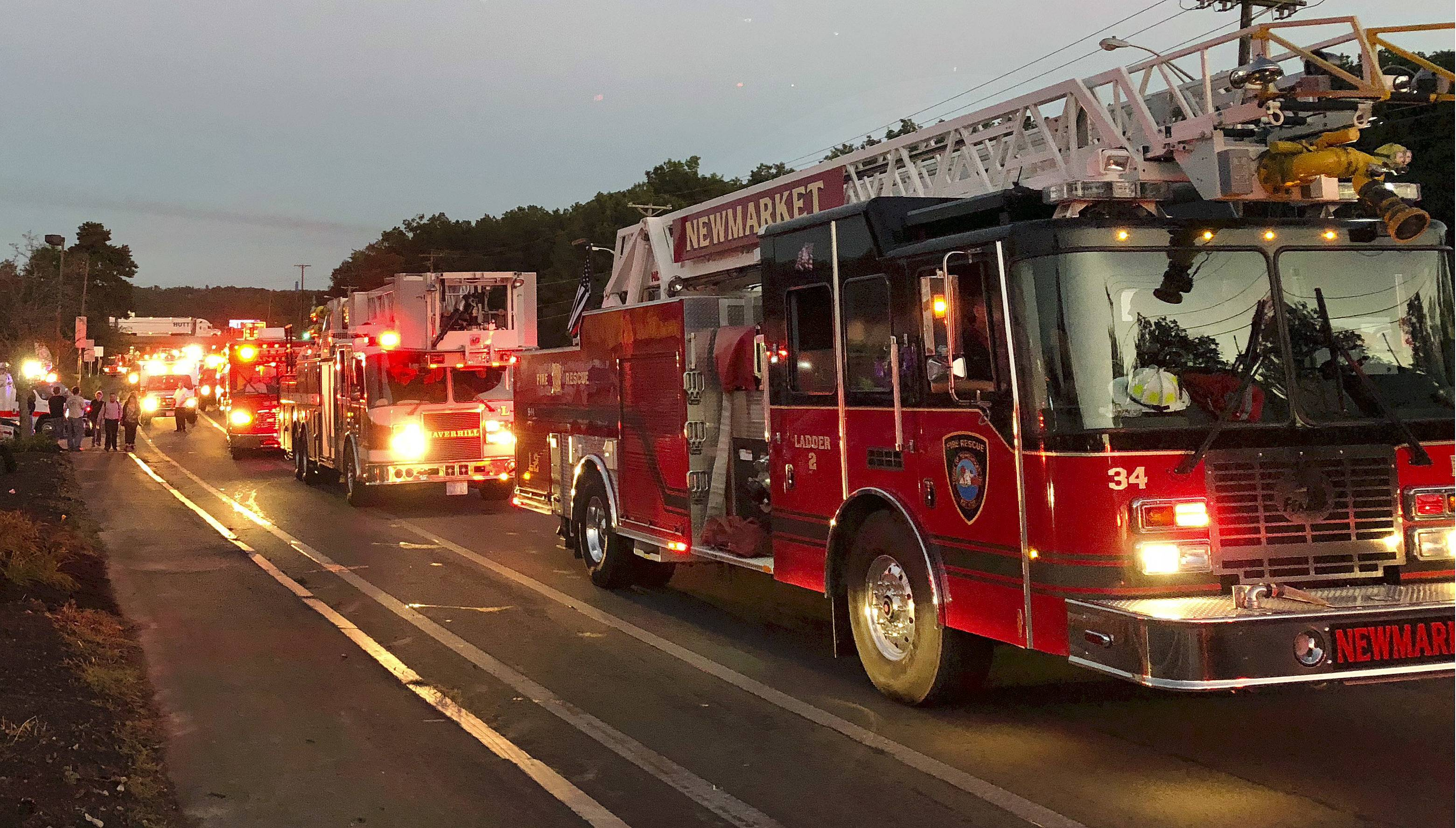 Multiple fire trucks from surrounding communities arrive Thursday, Sept. 13, 2018, in Lawrence, Mass., responding to a series of gas explosions and fires triggered by a problem with a gas line that feeds homes in several communities north of Boston.