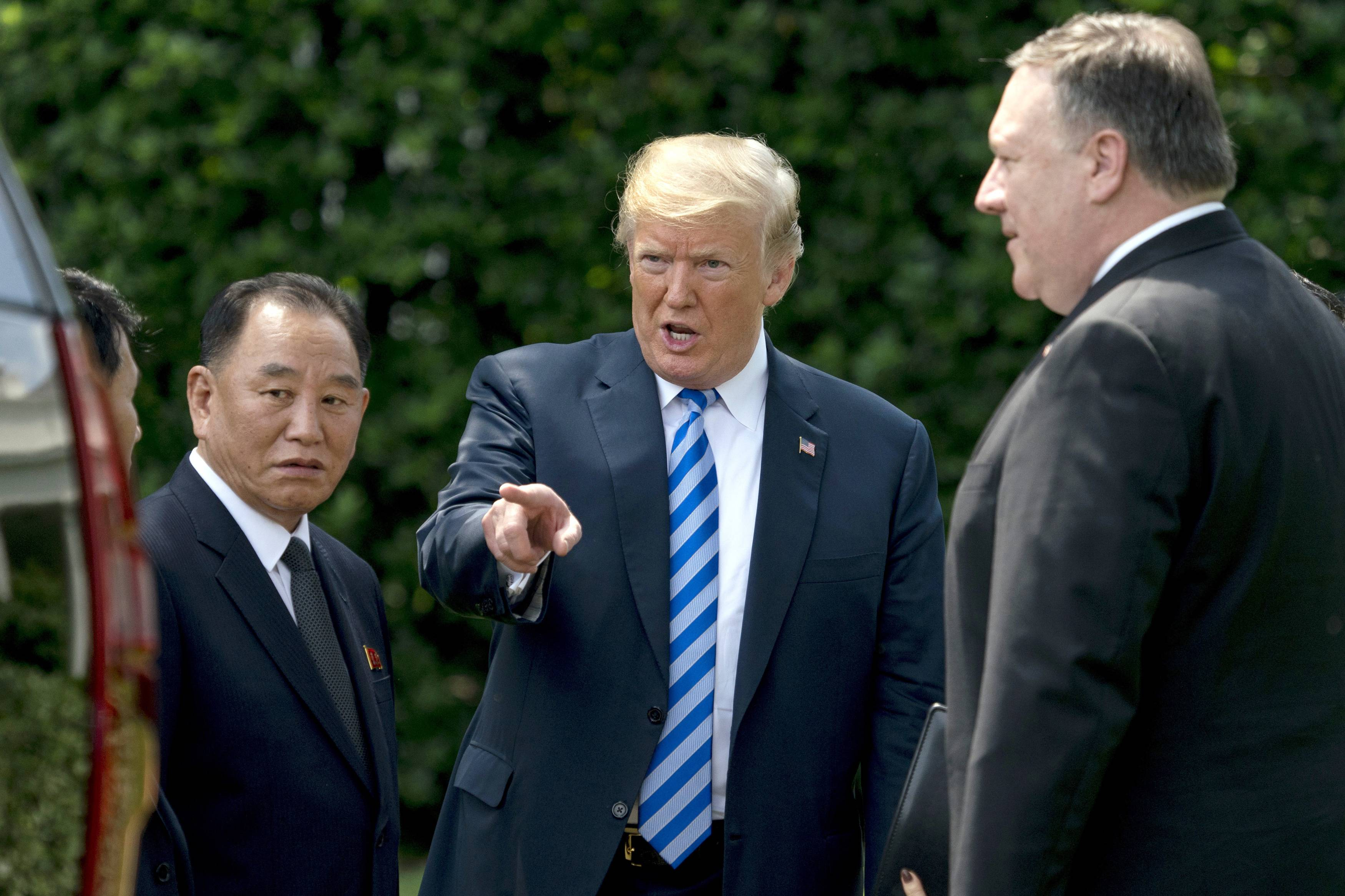 FILE -- In this June 1, 2018, file photo, President Donald Trump, center, talks with Kim Yong Chol, left, former North Korean military intelligence chief and one of leader Kim Jong Un's closest aides, and Secretary of State Mike Pompeo as they walk from their meeting in the Oval Office of the White House in Washington. In recent weeks it's become clear that Donald Trump wants to meet with Kim Jong Un again, and the North Korean leader has told the White House he'd like more face-to-face talks with the American president.