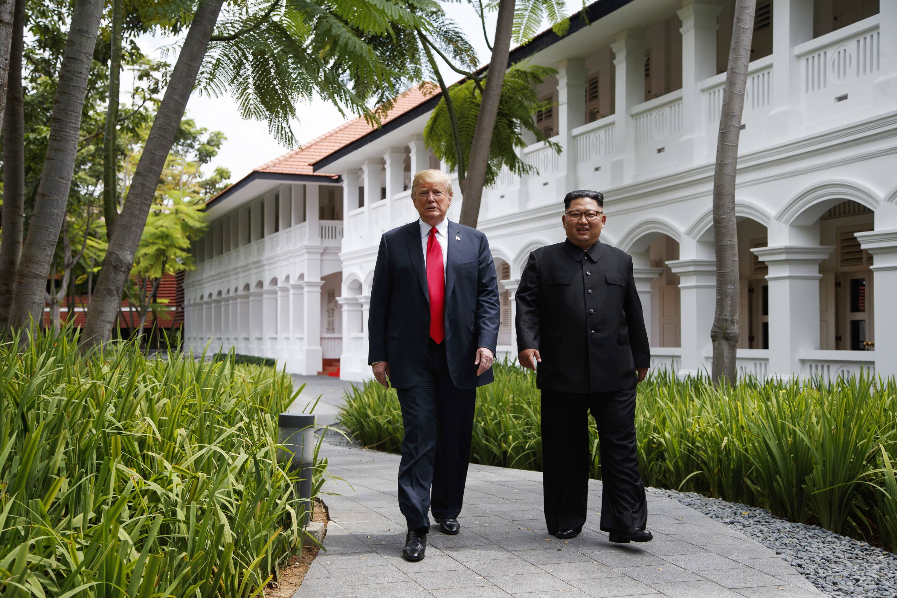 FILE -- In this June 12, 2018, file photo, President Donald Trump walks with North Korean leader Kim Jong Un on Sentosa Island in Singapore. In recent weeks it's become clear that Donald Trump wants to meet with Kim Jong Un again, and the North Korean leader has told the White House he'd like more face-to-face talks with the American president.
