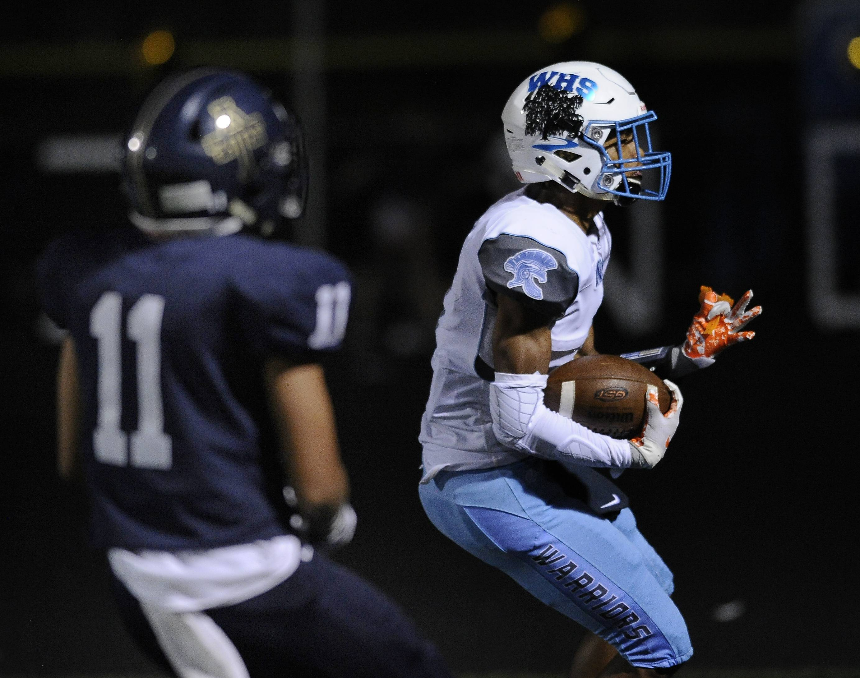 Addison Trail's Gonzalo Reyes tries to catch Willowbrook's Deandre Holliday on a touchdown.