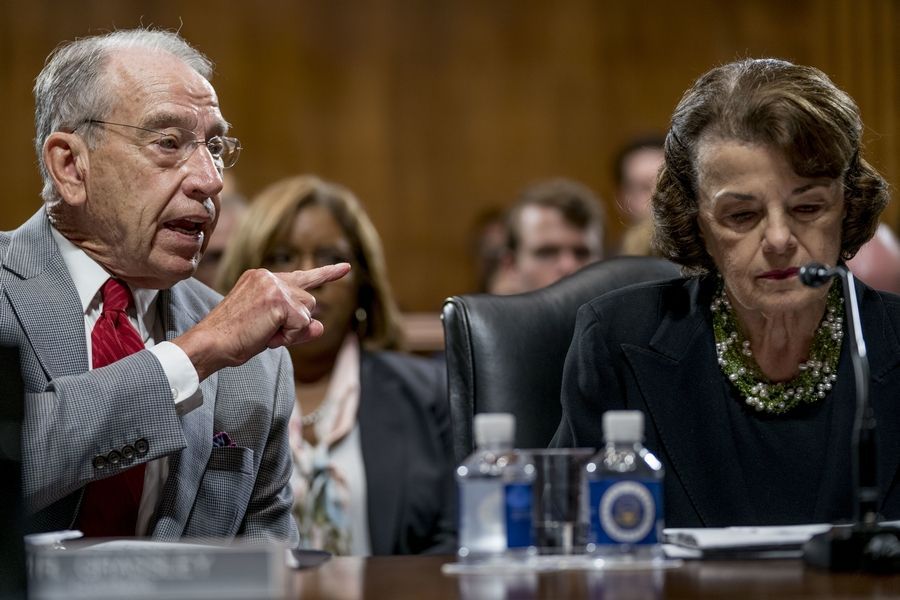 Senate Judiciary Committee Chairman Chuck Grassley, R-Iowa, left, accompanied by Sen. Dianne Feinstein, D-Calif., the ranking member, right, speaks during a Senate Judiciary Committee markup meeting on Capitol Hill, Thursday, Sept. 13, 2018, in Washington. The committee will vote next week on whether to recommend President Donald Trump's Supreme Court nominee, Brett Kavanaugh for confirmation. Republicans hope to confirm him to the court by Oct. 1.