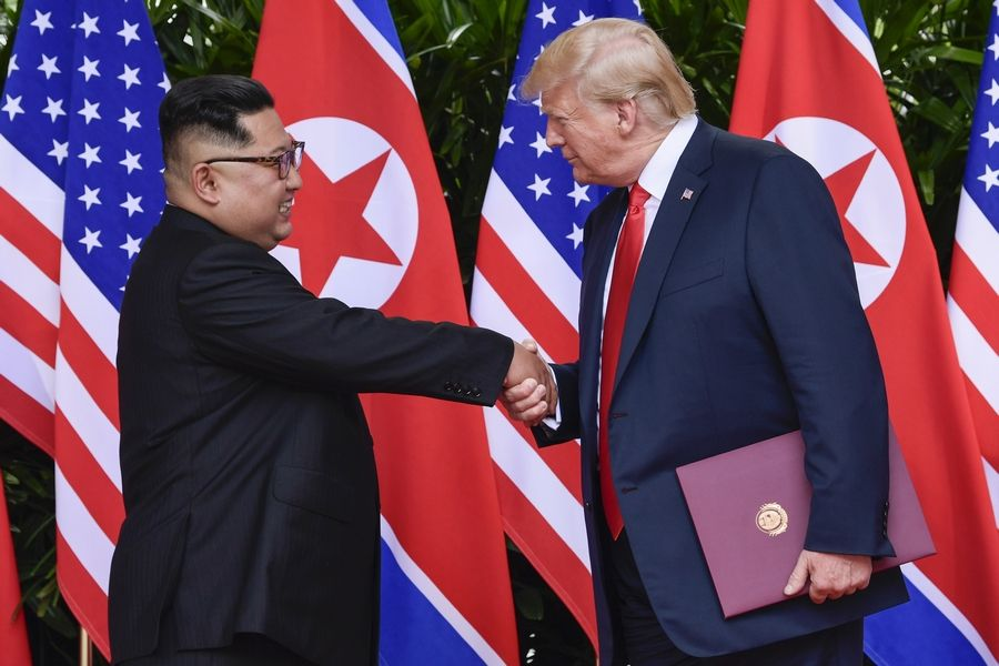 FILE -- In this June 12, 2018, file photo, North Korea leader Kim Jong Un, left, and U.S. President Donald Trump shake hands at the conclusion of their meetings at the Capella resort on Sentosa Island in Singapore. In recent weeks it's become clear that Donald Trump wants to meet with Kim Jong Un again, and the North Korean leader has told the White House he'd like more face-to-face talks with the American president.