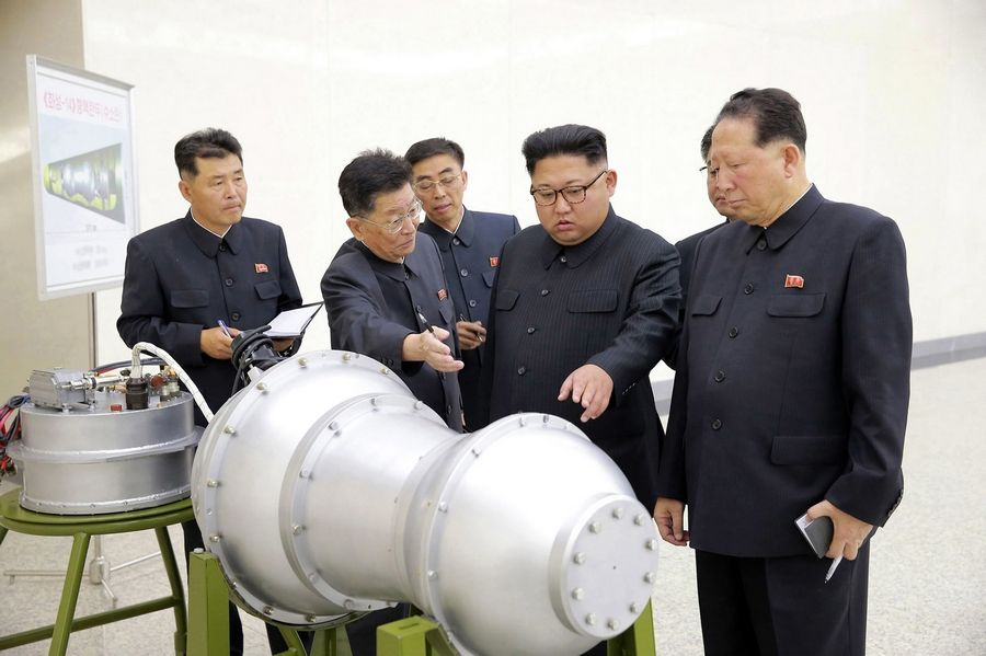 FILE -- This undated file photo distributed on Sept. 3, 2017 by the North Korean government, shows North Korean leader Kim Jong Un, second from right, at an undisclosed location in North Korea. In recent weeks it's become clear that Donald Trump wants to meet with Kim Jong Un again, and the North Korean leader has told the White House he'd like more face-to-face talks with the American president. (Korean Central News Agency/Korea News Service via AP, File)