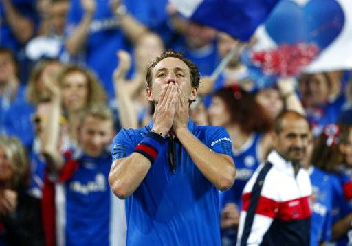 France's Lucas Pouille reacts after defeating Spain's Roberto Bautista Agut during the Davis Cup semifinals France against Spain, Friday, Sept. 14, 2018, in Lille, northern France. (AP Photo/Michel Spingler))