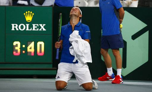 France's Lucas Pouille reacts after defeating Spain's Roberto Bautista Agut during the Davis Cup semifinals France against Spain, Friday, Sept.14, 2018 in Lille, northern France.