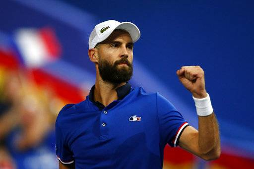 France's Benoit Paire reacts as he plays Spain's Pablo Carreno Busta during the Davis Cup semifinals France against Spain, Friday, Sept.14, 2018 in Lille, northern France.