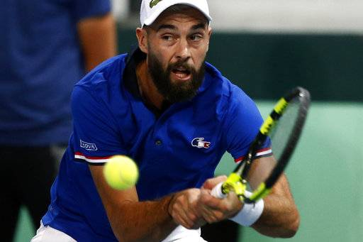 France's Benoit Paire returns the ball to Spain's Pablo Carreno Busta during the Davis Cup semifinals France against Spain, Friday, Sept.14, 2018 in Lille, northern France.