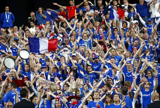 Supporters of the French tennis team wave before the Davis Cup France against Spain, Friday, Sept.14, 2018 in Lille, northern France.