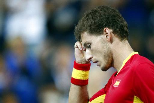 Spain's Pablo Carreno Busta reacts as he plays France's Benoit Paire during the Davis Cup semifinals France against Spain, Friday, Sept.14, 2018 in Lille, northern France.