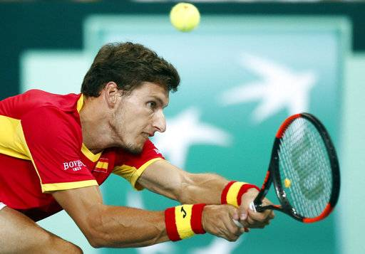 Spain's Pablo Carreno Busta returns the ball to France's Benoit Paire during the Davis Cup semifinals France against Spain, Friday, Sept.14, 2018 in Lille, northern France.
