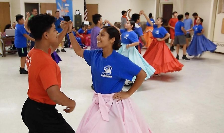 While her entire family plays a role with the Grupo De Danza Folklorica Quetzaly dance group, Ashley Gasca, 14, middle, says she considers all the dancers family. A freshman at South Elgin High School, she says she enjoys learning about her Mexican heritage through folk dances.