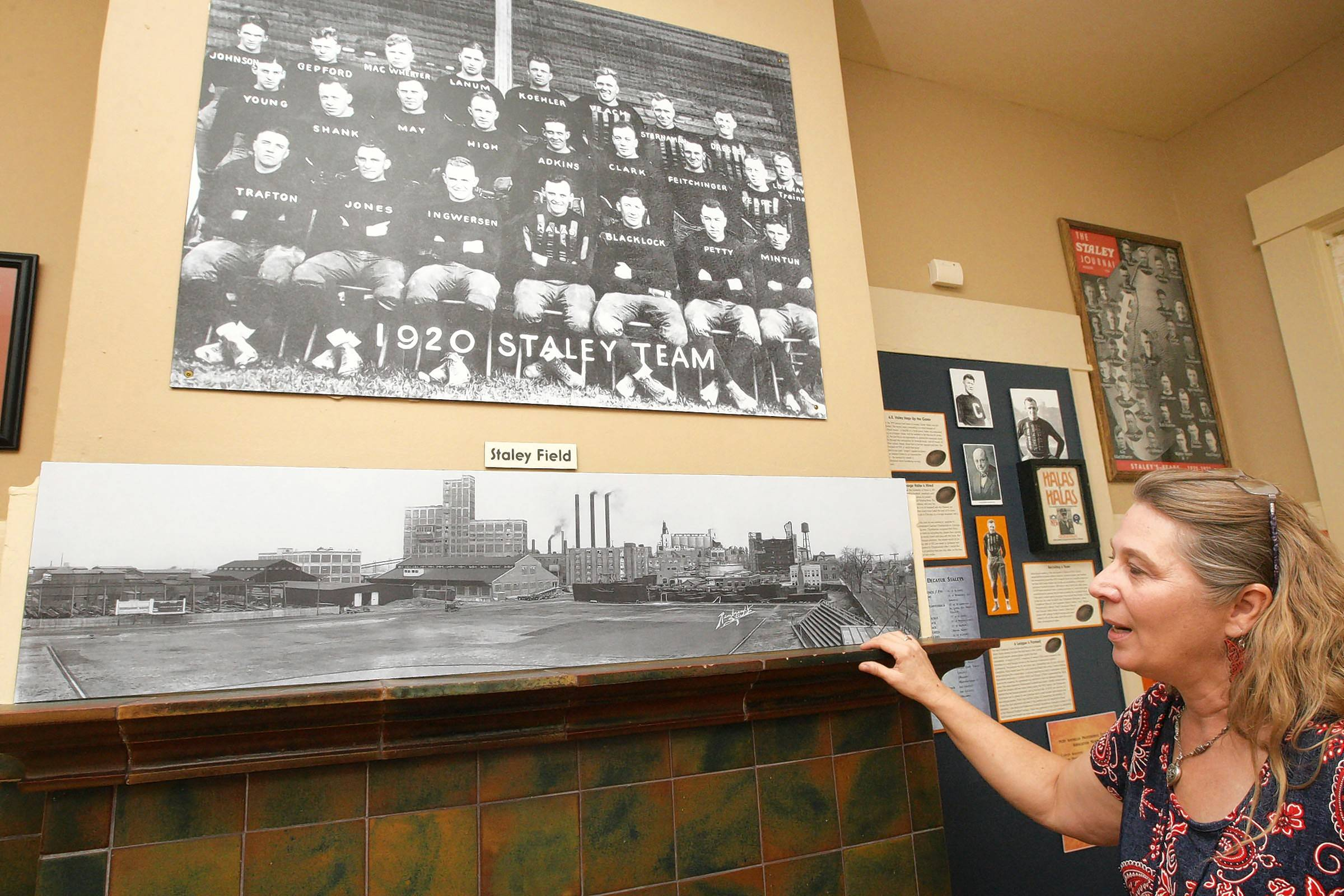 Laura Jahr, director of the Staley Museum in Decatur, shows a team photo of the Decatur Staleys football team. The team later became the Chicago Bears.