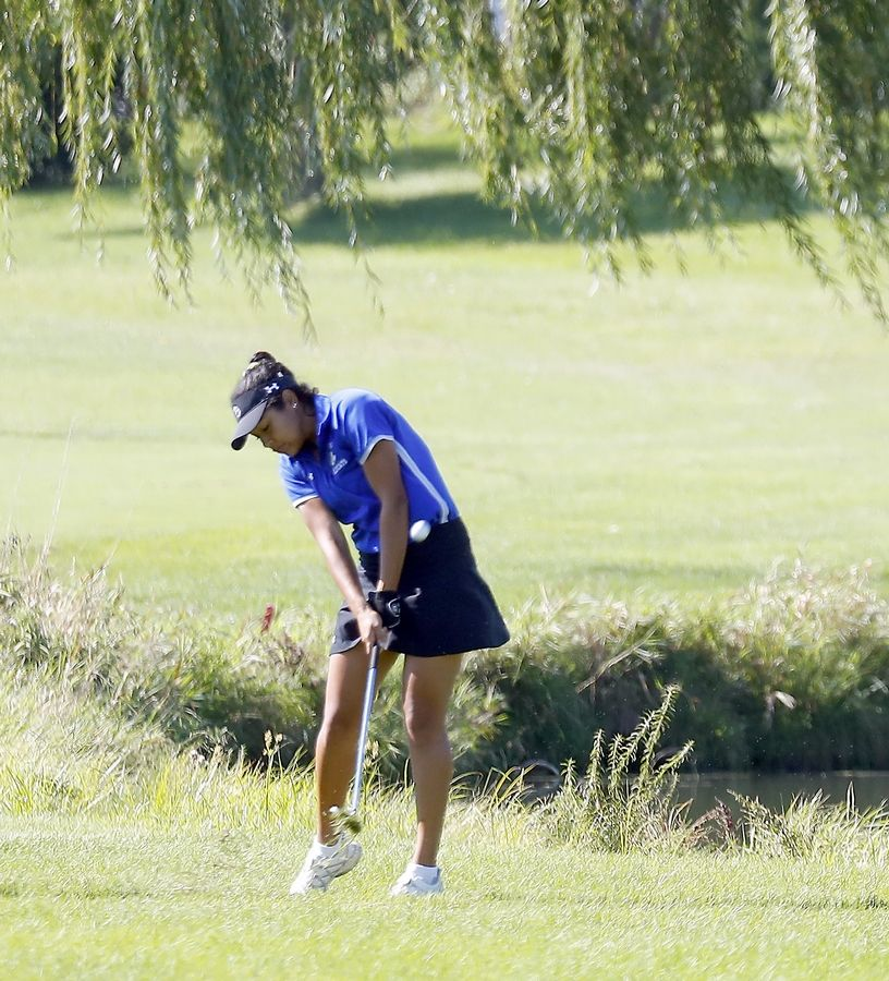 Wheeling's Adrienne Rohwedder during the Glenbard East girls golf invitational Saturday at Glendale Lakes Golf Course in Glendale Heights.