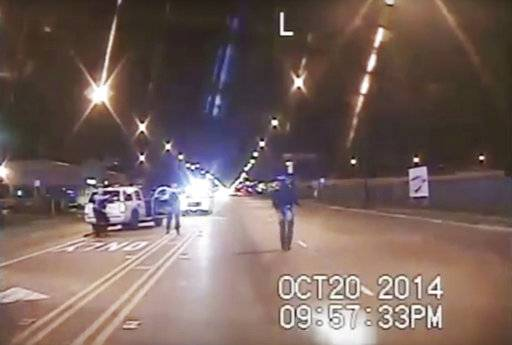 FILE - In this Oct. 20, 2014 image made from dashcam video provided by the Chicago Police Department, Laquan McDonald, 17, right, walks down the street moments before being fatally shot by Chicago Police Officer Jason Van Dyke in Chicago. (Chicago Police Department via AP, File)