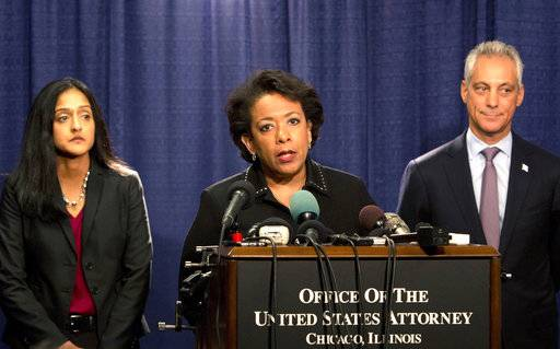 FILE - In this Friday, Jan. 13, 2017 file photo, U.S. Attorney General Loretta Lynch speaks during a news conference accompanied by Principal Deputy Assistant Attorney General Vanita Gupta, left, and Mayor Rahm Emanuel in Chicago. The U.S. Justice Department issued a scathing report on civil rights abuses by the Chicago Police Department. The report described a department that tolerated racial discrimination and used excessive force.