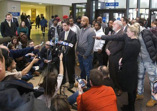 FILE - In this Thursday, Nov. 16, 2017 file photo, Leonard Gipson, center right, one of 15 convicted men, accompanied by Joshua Tepfer, center left, of the University of Chicago's Exoneration Project, talks to reporters in Chicago, after a judge threw out the convictions of the men who claimed former Police Sgt. Ronald Watts had manufactured evidence that sent them to prison.