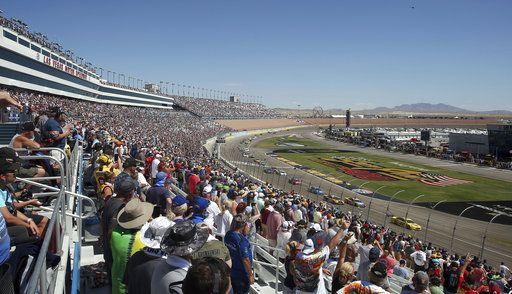 Fans stand for the beginning of a NASCAR Cup Series auto race Sunday, Sept. 16, 2018, in Las Vegas.