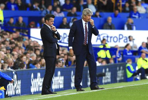 Everton manager Marco Silva, left, and West Ham United manager Manuel Pellegrini look on from the sidelines during their English Premier League soccer match at Goodison Park in Liverpool, England, Sunday Sept. 16, 2018. (Peter Byrne/PA via AP)