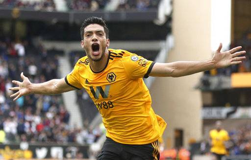 Wolverhampton Wanderers' Raul Jimenez celebrates scoring his side's first goal of the game during the English Premier League soccer match between Wolverhampton Wanderers and Burnley, at Molineux, in Wolverhampton, England,  Sunday Sept. 16, 2018. (Nick Potts/PA via AP)