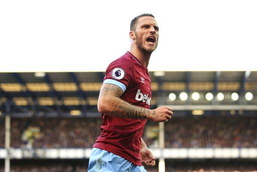 West Ham United's Marko Arnautovic celebrates scoring his side's third goal of the game , during the English Premier League soccer match between Everton and West Ham United, at Goodison Park, Liverpool, England, Sunday Sept. 16, 2018. (Peter Byrne/PA via AP)